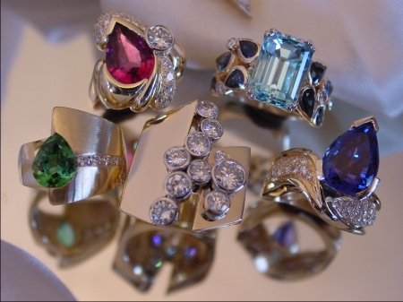 custom diamond, emerald, sapphire, gold, and silver rings